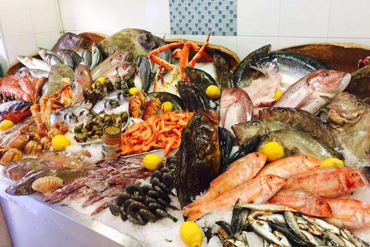 Variety of fresh seafood and fish in display in the Poissonnerie La Sirene shop