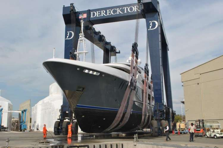 Superyacht on a travel lift at Derecktor shipyard in Dania, Florida.