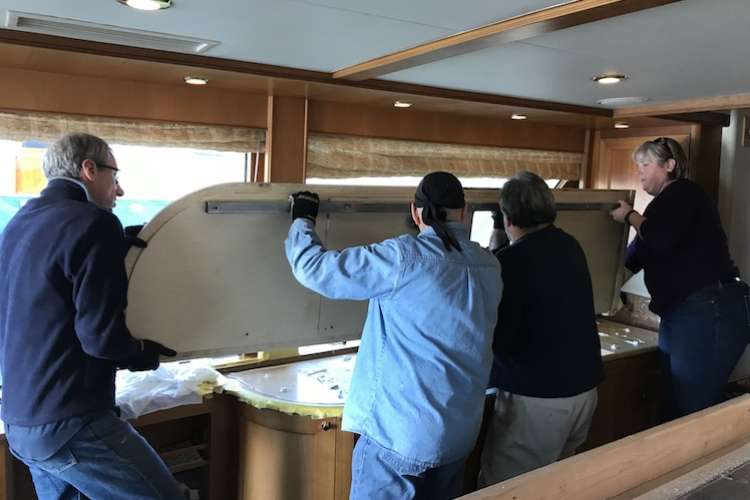 Pacific Yacht Management team installing custom cabinets