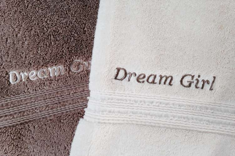 Custom embroider towels in grey and white with text 'Dream Girl'