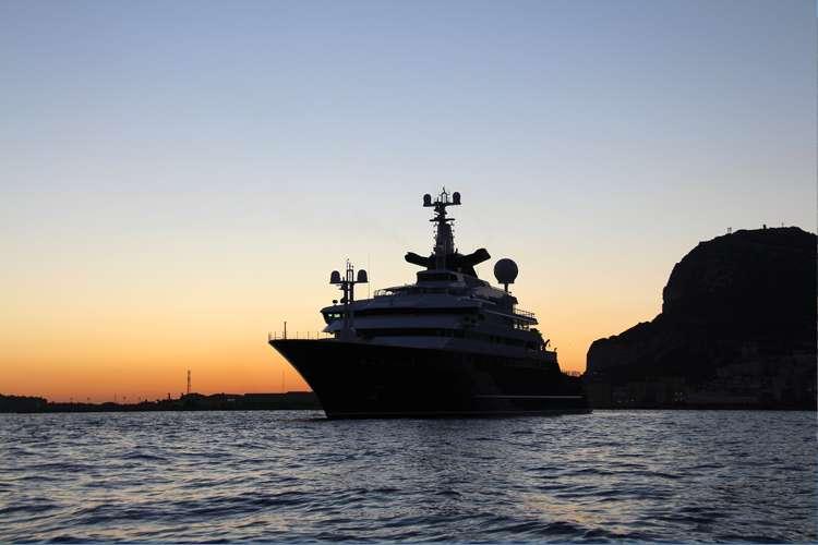 Superyacht cruising in the  sunset