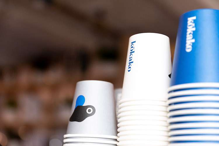 Blue and white paper mugs in different sizes