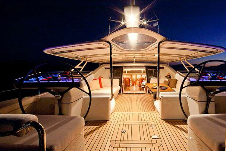 Superyacht sun deck in during dark furnished by Universal Nautic