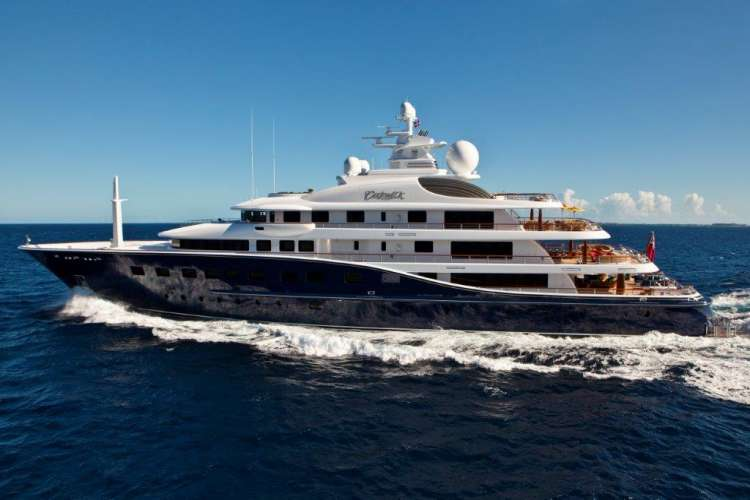 Mega yacht cruising in the sea with clear blue sky in the background.