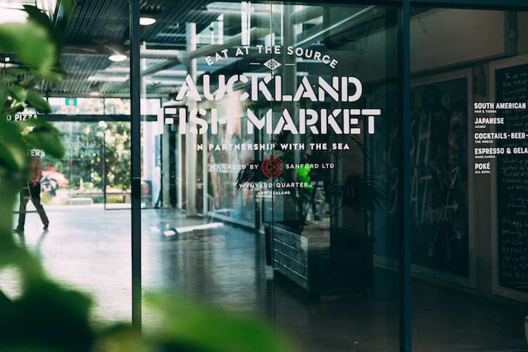Auckland Fish Market displayed through glass doors.