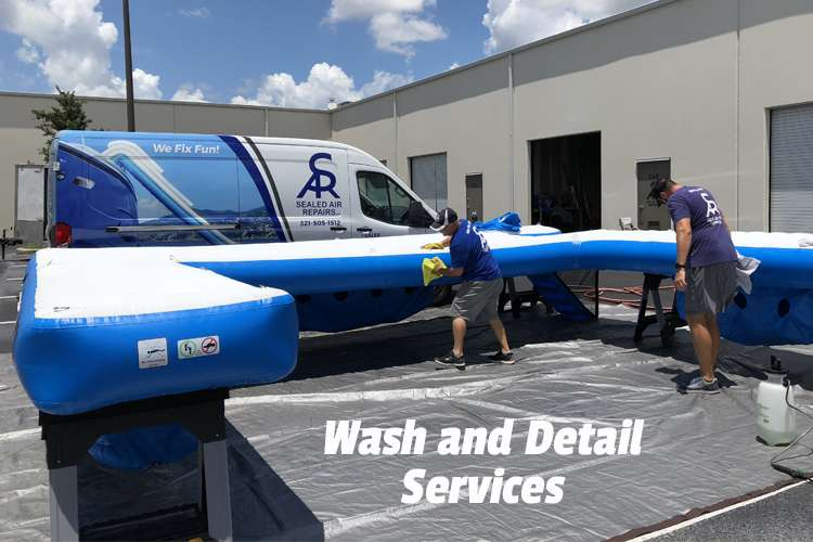 Sealed Air Repairs team washing an inflatable.