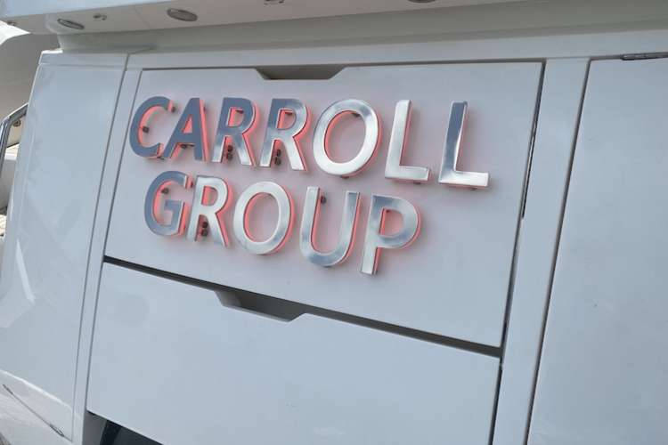 Illuminated silver yacht signage on superyacht Carroll Group