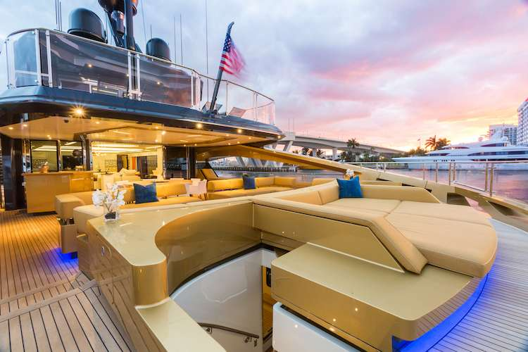 Khalilah superyacht bar area and fitted leather couches on the sundeck
