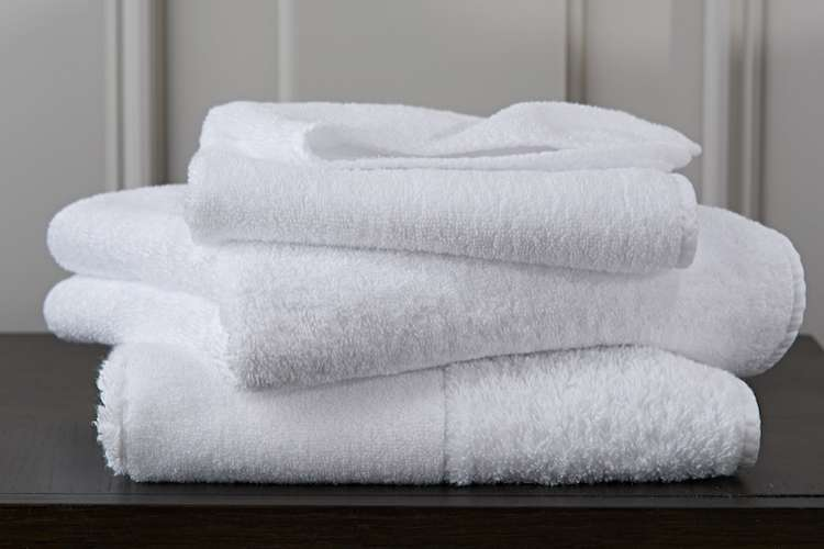 Pile of white fluffy towels from Heirlooms.