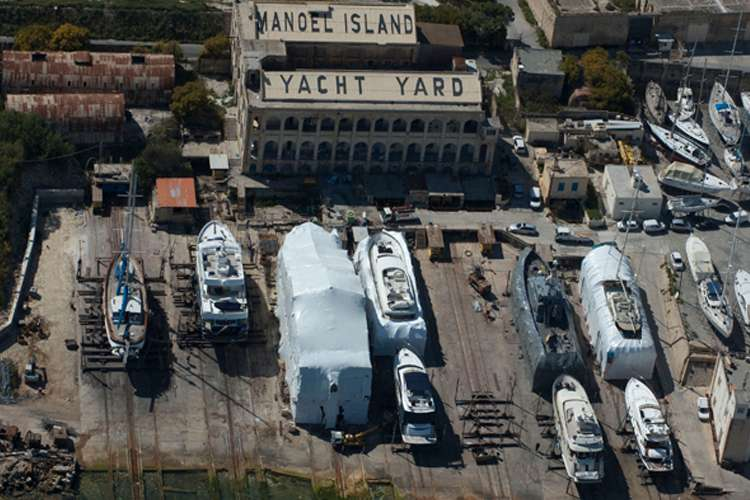 Aerial image of the Manoel Island shipyard with superyachts dry docking on the yard.
