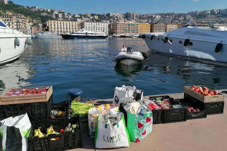 Yacht provisions, fresh fruit, and vegetables waiting in a port to be delivered to a yacht