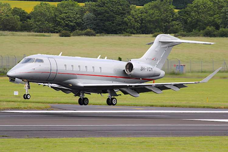 Silver coloured Private jet about to take off