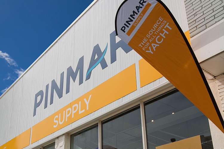 Pinmar Supply store front with a Pinmar Supply flag