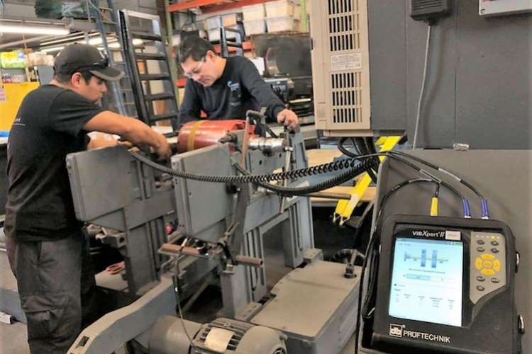 Two engineers working in a machine room