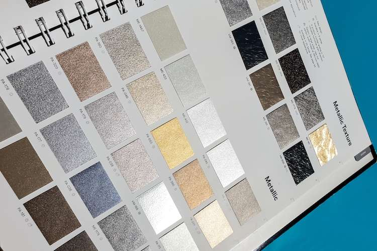 Image of a catalogue of wrap film samples of metallic texture and metallic in different colours