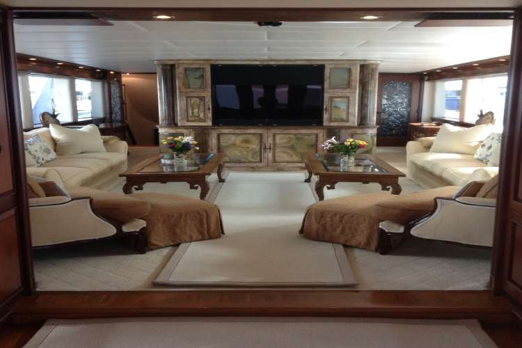 Living area in a superyacht with leather couches and armchairs