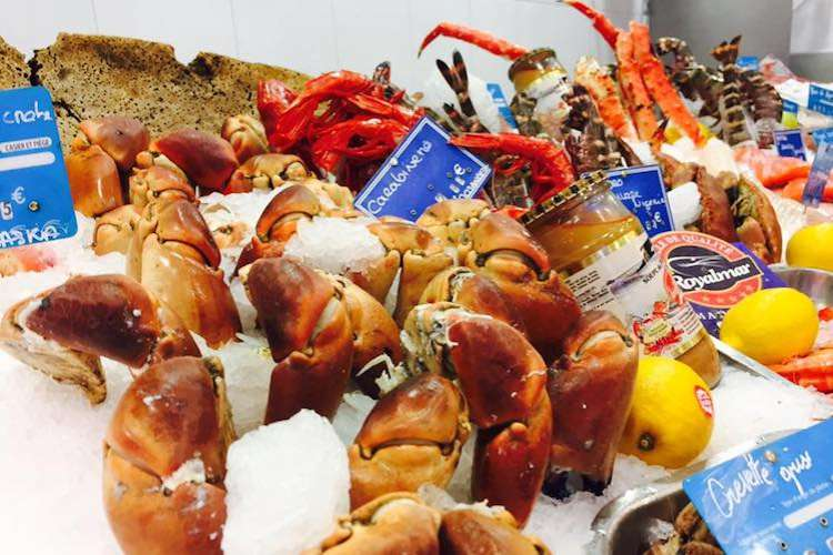Mix of fresh seafood in display in the Poissonnerie La Sirene shop