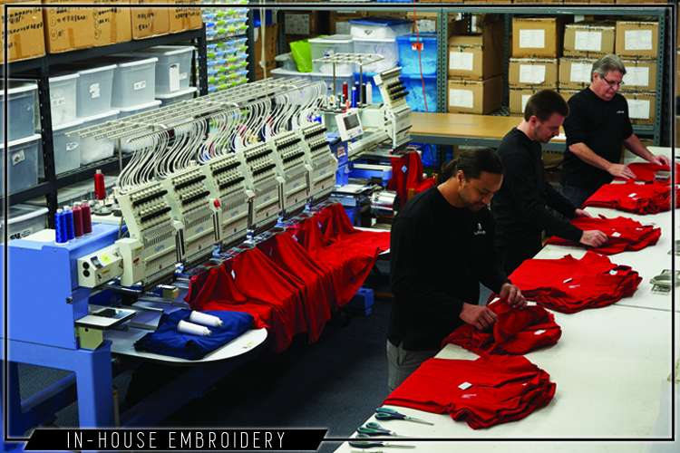 Liquid Yacht Wear team making embroidery in the production facility