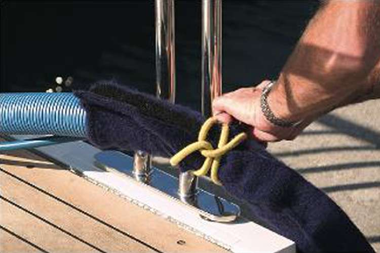 Man attaching a cleaning hose