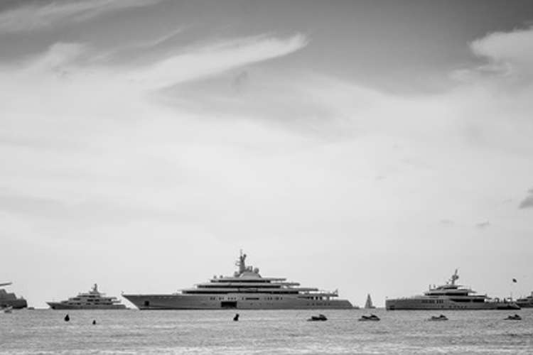 multiple superyacht on anchor