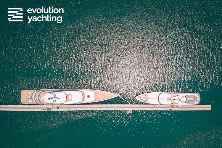 Two superyachts bow to bow from a birds eye view