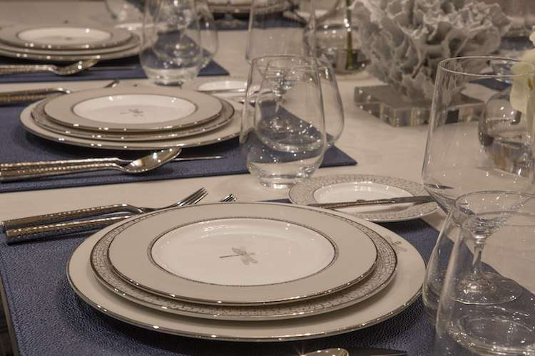 Dining table set with luxurious table ware by Karen Lynn Interior Design