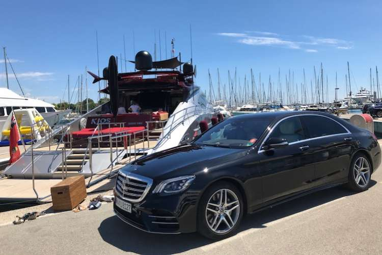 Black Ruby Services Mercedes parked in front of a berthing superyacht