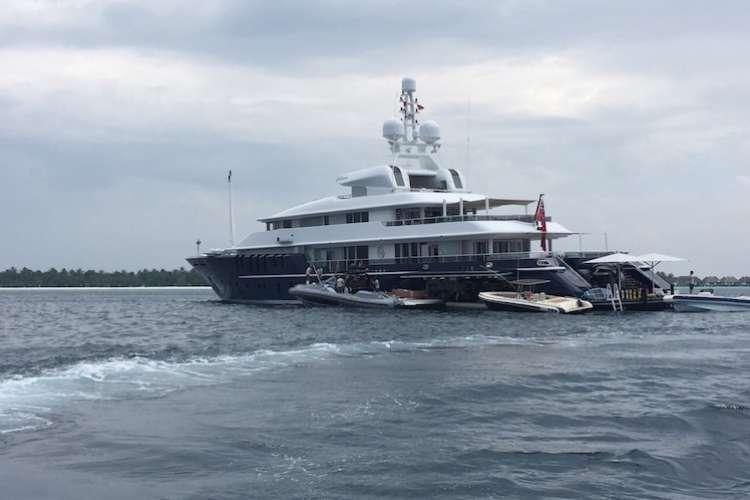 Superyacht ancored close to a coastline.