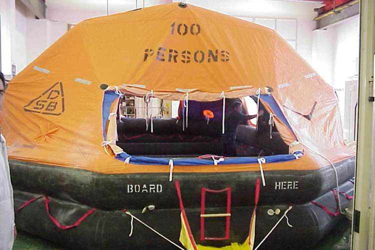 Image of an orange and black inflatable life boat
