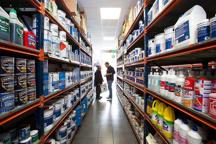 Image of people between shelves in a Pinmar Supply store