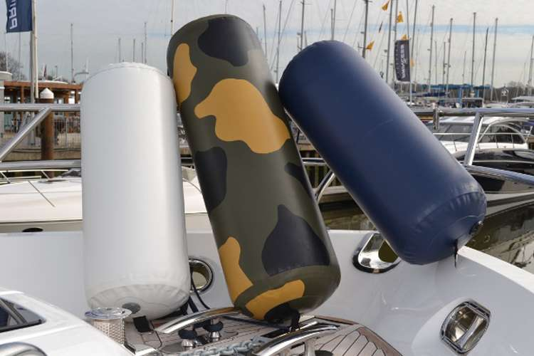 Image of M2M fenders in different colours on a yacht deck.