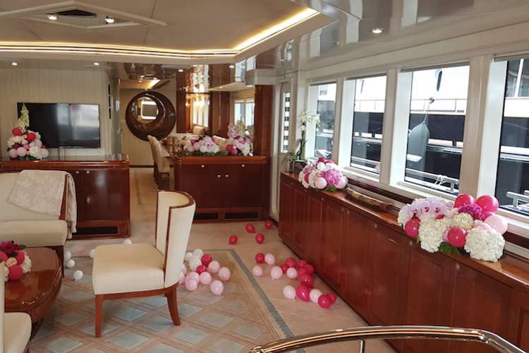 Superyacht living room decorated with pink and white flowers and balloons