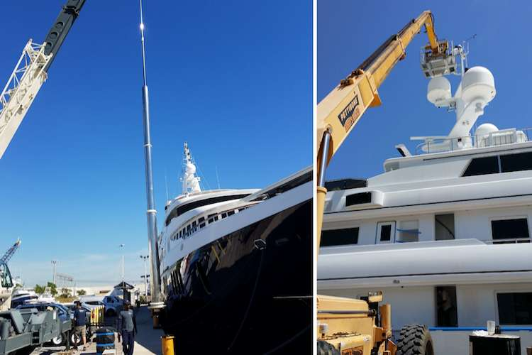 Crane lifting superyacht machinery to a superyacht