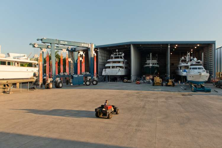 Image of a shipyard with yachts dry docking in a hangar