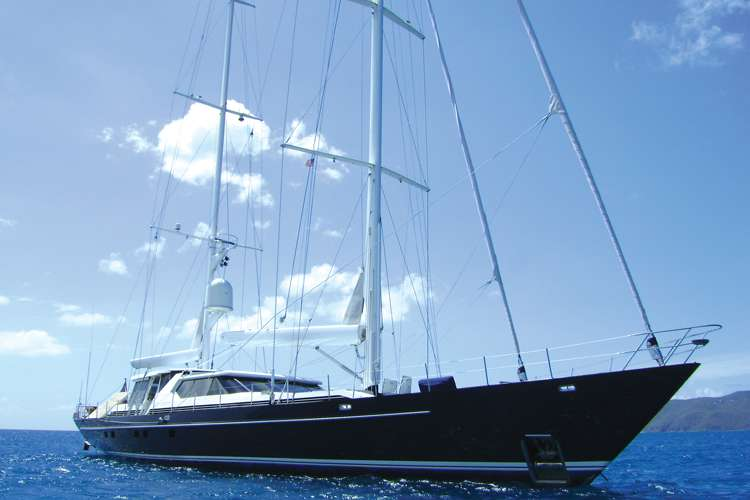 image of an anchored sailing yacht with clear blue sky in the background