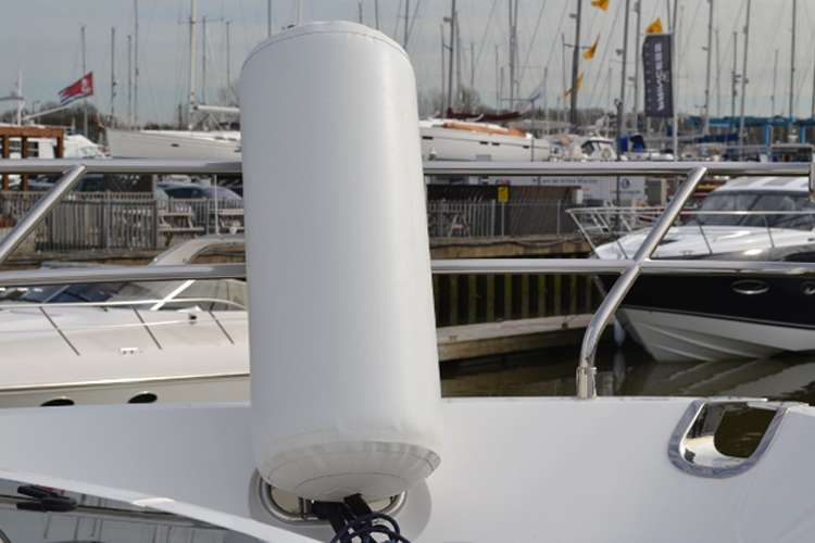 Image of a white M2M fender on a yacht deck.