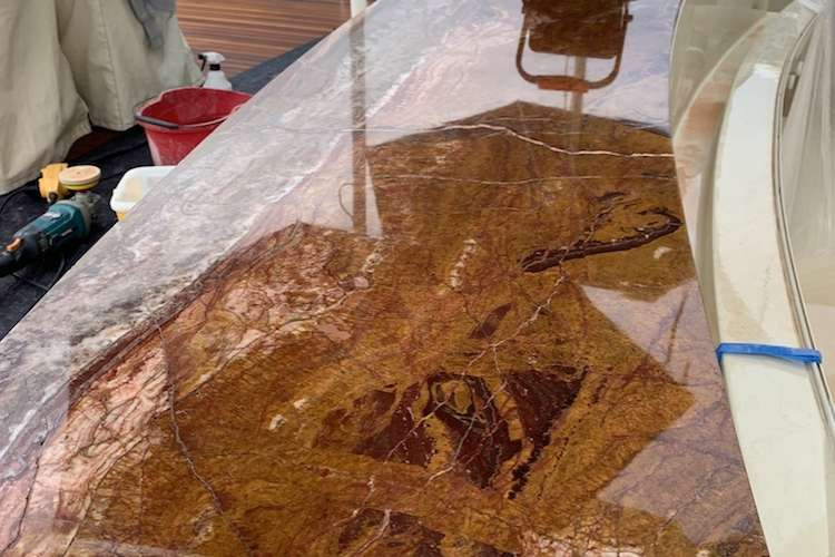 Shiny brown marble table polished and treated by Proshield
