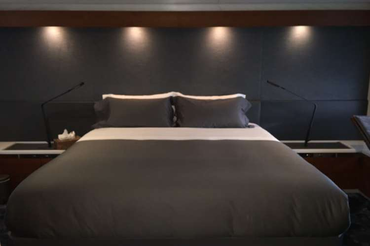 Superyacht master bedroom furnished by Universal Nautic