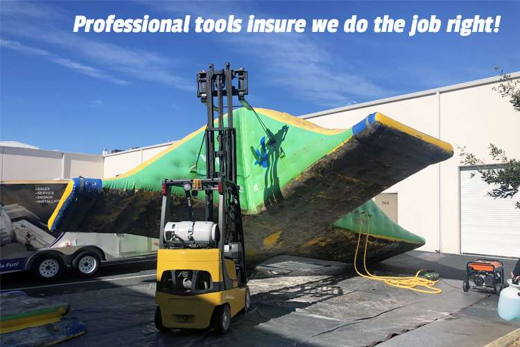 Image of a crane lifting an inflatable with text: Professional tools insure we do the job right