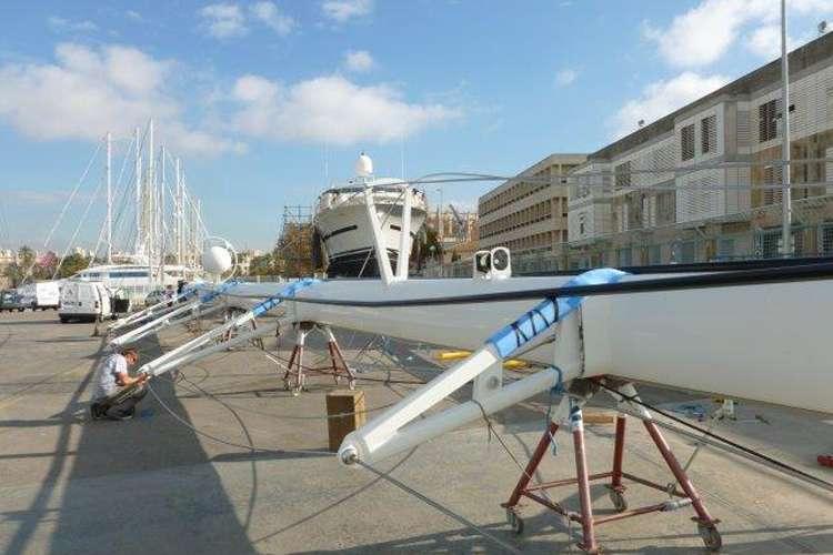 Sailing mast laid on a platform in a shipyard