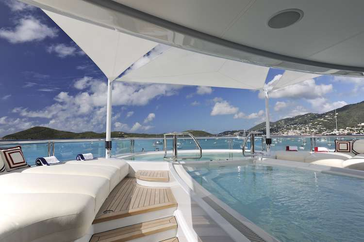 White leather sun lounge beds surrounding the swimming pool on  S/Y Madsummer 326