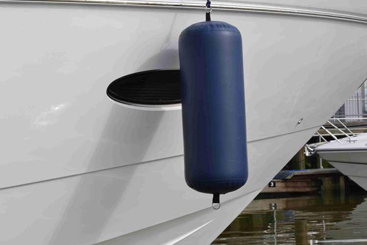 Image of a dark blue M2M Fender hanging on a superyacht side.