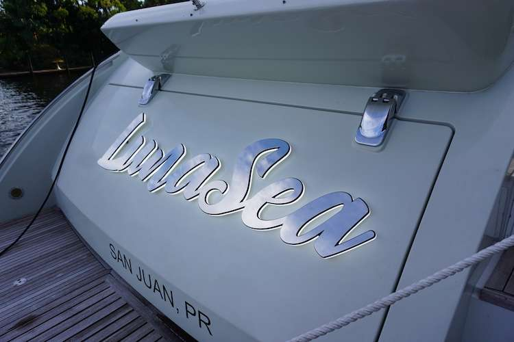Shiny and silver yacht signage on superyacht LunaSea