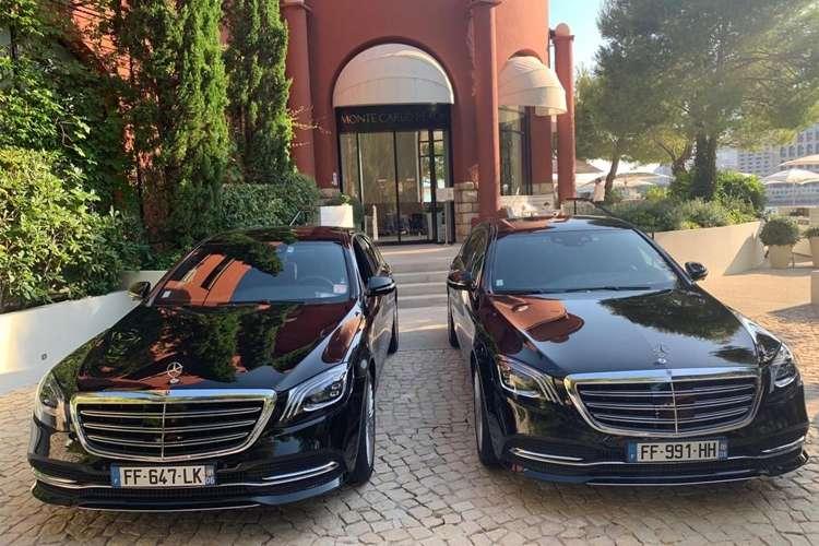 2 luxury cars side by side