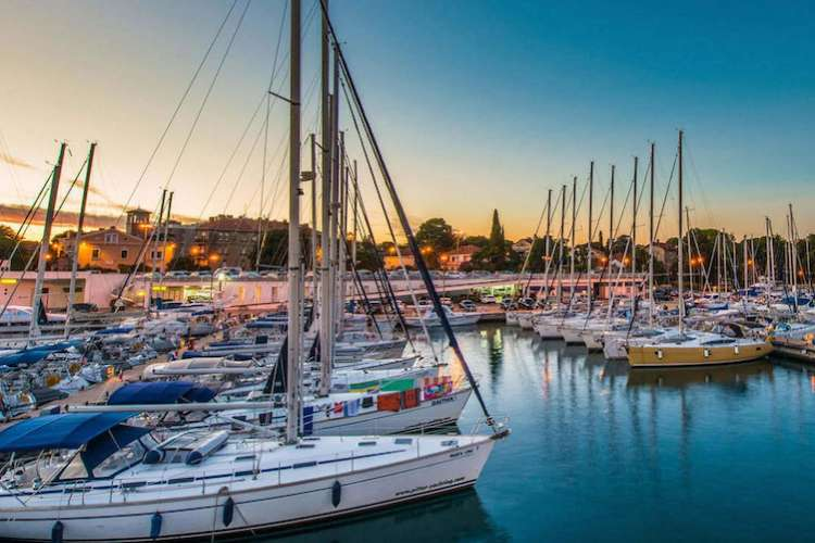 Image of a port with sailing yachts.