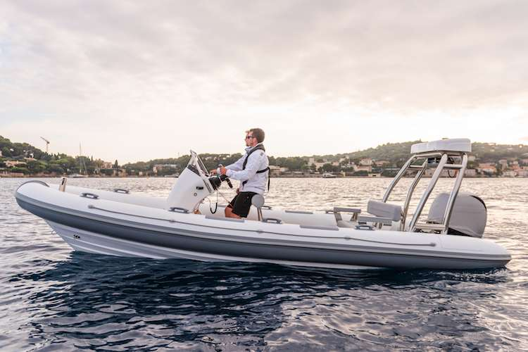 Man driving a Ribeye boat