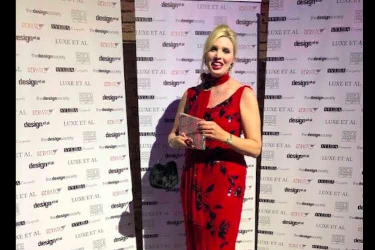 Karen Lynn smiling and standing in the international Yacht & Aviation Awards 2019.