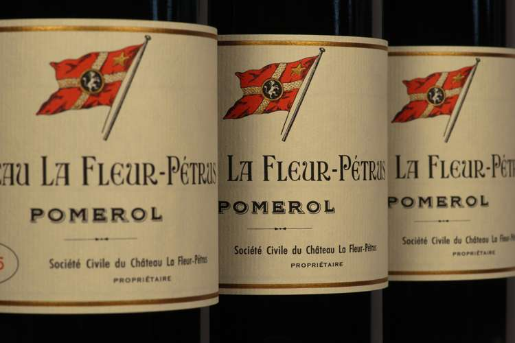 Three bottles of Chateau La Fleur-Petrus Pomerol red wine.