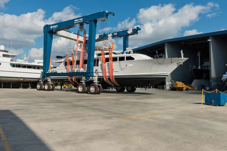 Yacht being lifted on ground