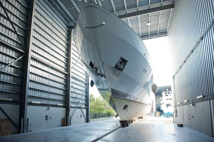 A superyacht dry docking in a hangar